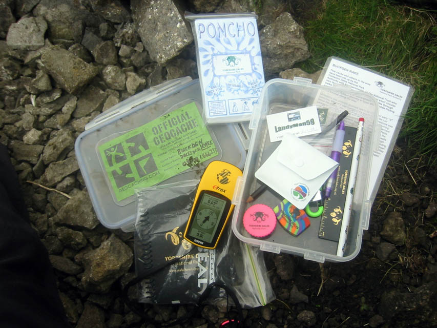 Geocache box and its contents