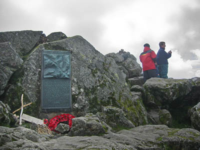 The memorial plaque at Great Gable's summit, with a poppy wreath