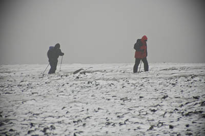 Walkers in bad weather on a summit