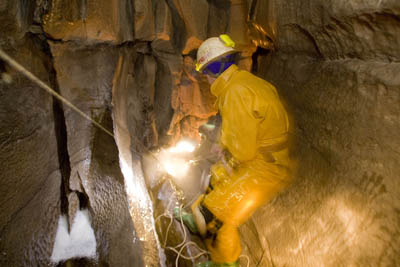 Cavers tackle a pitch in Lower Long Churn Cave