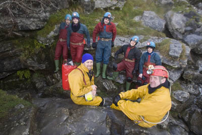 Back in daylight: leaders Stuart, left, and Neil, with the team of caving novices at the exit from Upper Long Churn Cave
