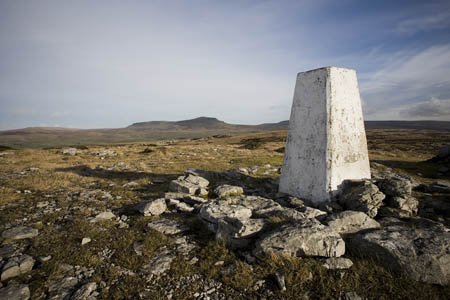 The summit trig point, looking towards Pen-y-ghent