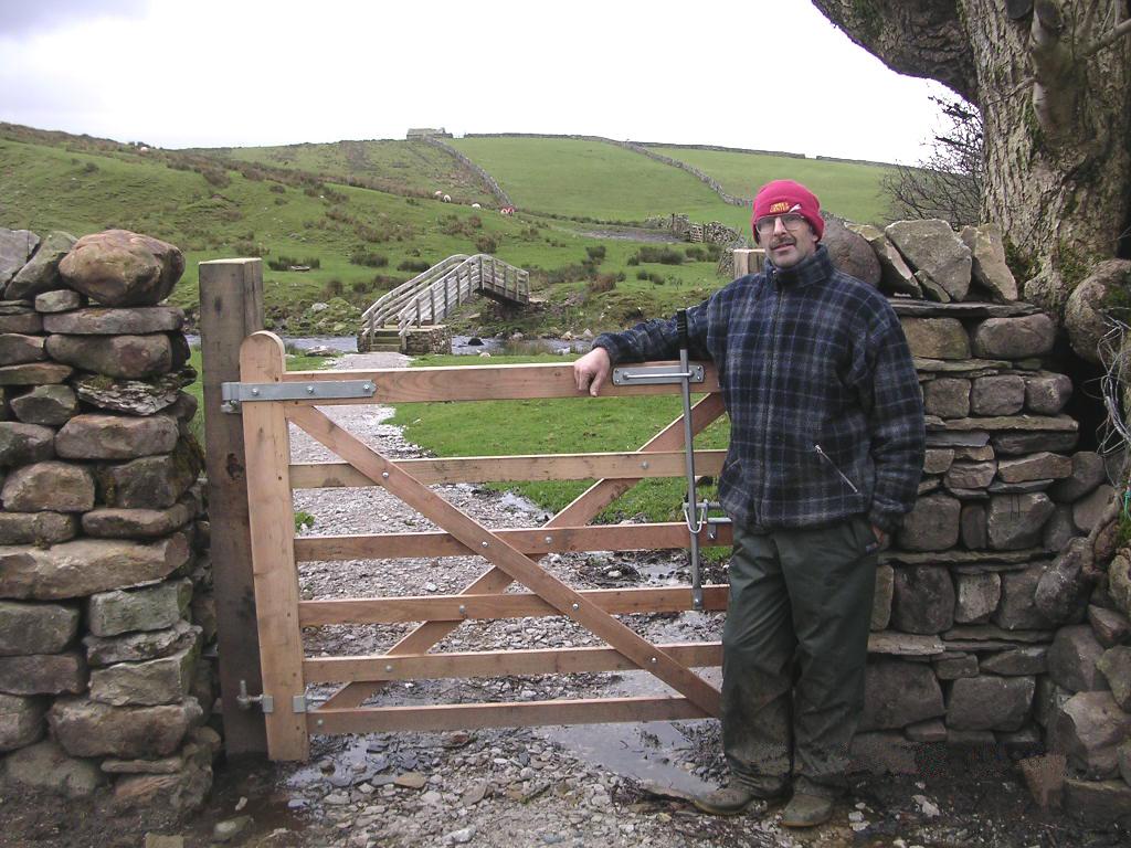 Farmer John Sedgewick with the footbridge in the background