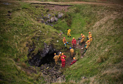 Cavers prepare to descend a pothole in the Yorkshire Dales