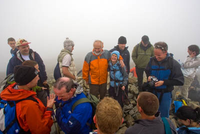 Sir Chris poses with walkers on the top of Scafell Pike