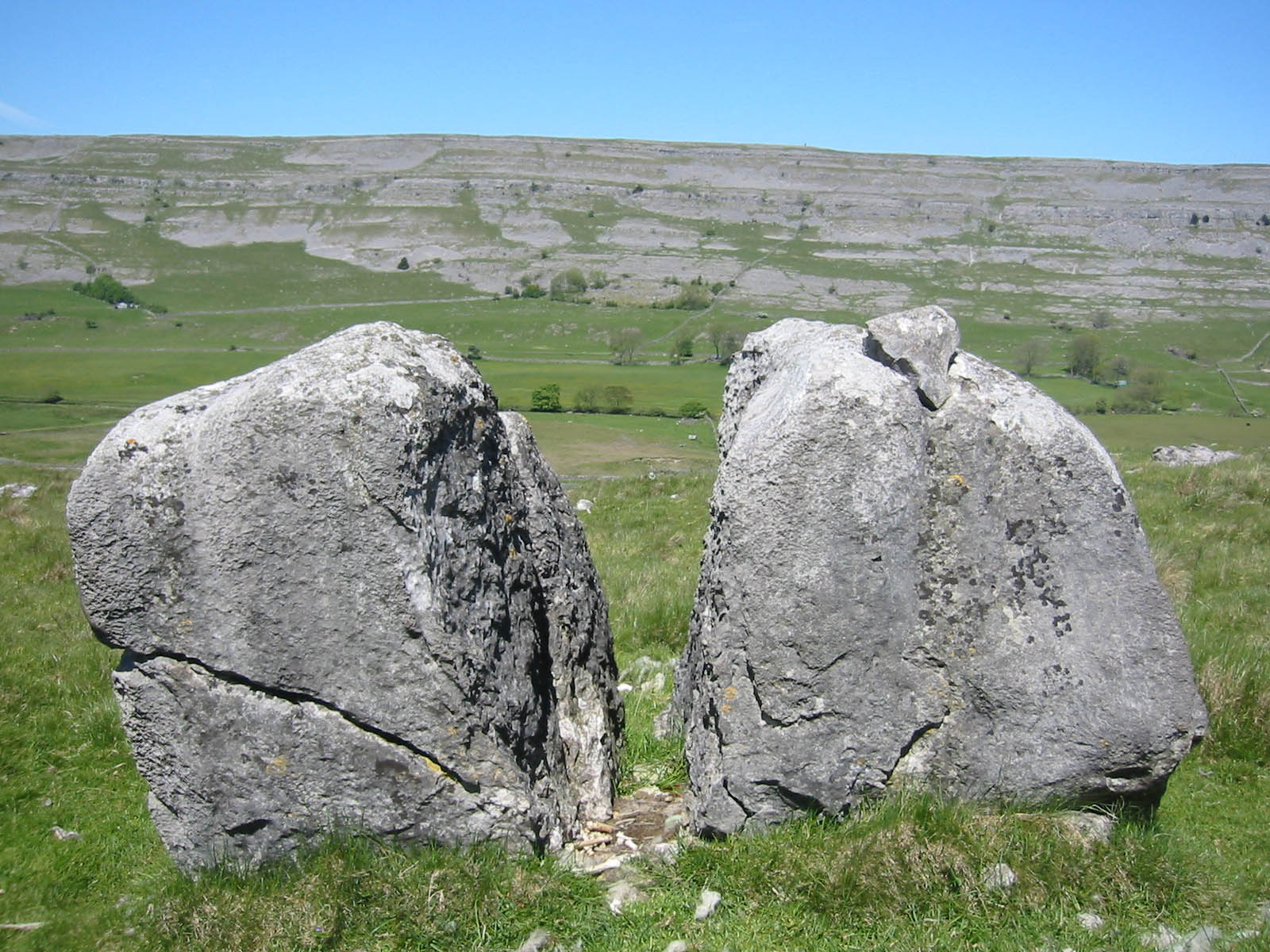 Cleft boulder, with sheep remains