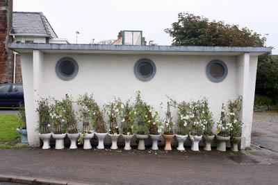 The toilet block at St Bees, complete with a row of planted toilet pans