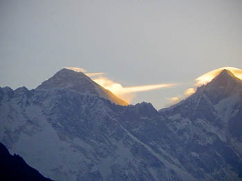 Everest shows its awesome beauty as sunlit cloud streaks from its ridge
