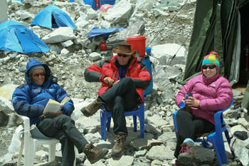 Jacqui, right, manages a smile at base camp despite her illness