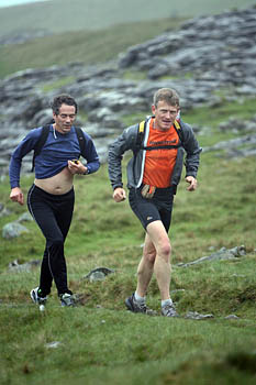 Fellsman winner Mark Hartell, on right of picture, early in the race, ascending Ingleborough