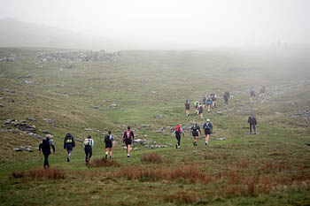Hikers head into the cloud on Ingleborough