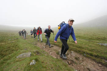 Fellsman Hikers en route to their first peak, Ingleborough