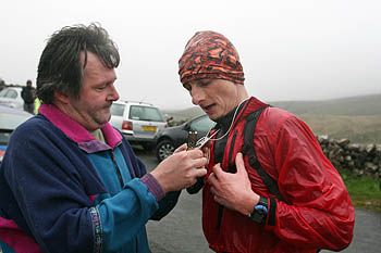 A hiker has his tally clipped at Kingsdale checkpoint