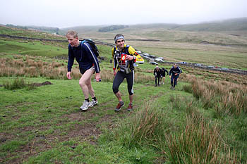 Cheers! Competitors start the climb to Gragareth after refuelling at Kingsdale