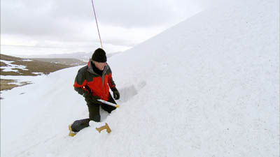 Griff Rhys Jones digging a snow hole to sleep in on Cairn Gorm plateau