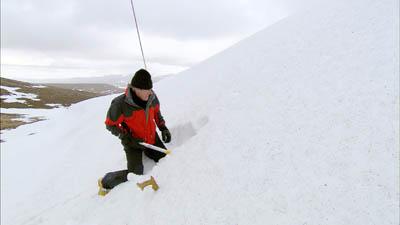 Griff Rhys Jones digging a snow hole to sleep in on Cairn Gorm plateau