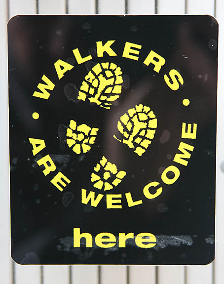 Walkers Are Welcome sticker in local shop window