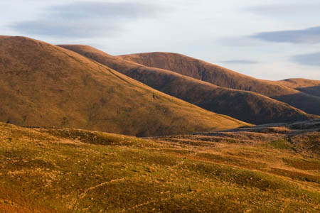 Late winter sunshine illuminates the slopes of the Howgills