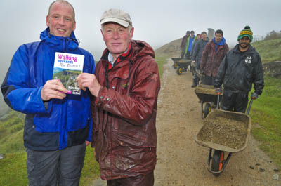 Author Mark Reid, left, with Peak District national park ranger Terry Page as the path is constructed by volunteer helpers from the Oldham and Rochdale Groundwork Trust