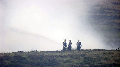 Firefighters tackle a moorland fire