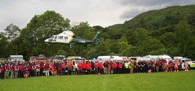 The teams line up as the Great North Air Ambulance flies overhead