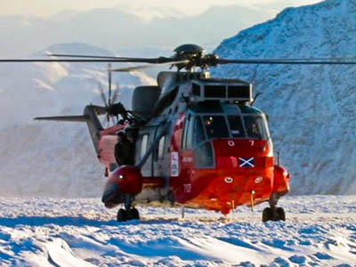 A Royal Navy Sea King at work in the mountains. Photo: Royal Navy