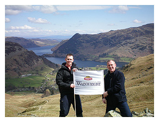 Thwaites employees Martin and Paul Shearer unfurl one of the flags en route for Helvellyn