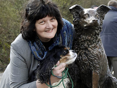 Sculptress JOEL is pictured with the bronze sculpture of Ruswarp, and her own cavalier king charles spaniel Chloe