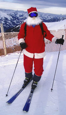 Santa Claus skiing in the mountains