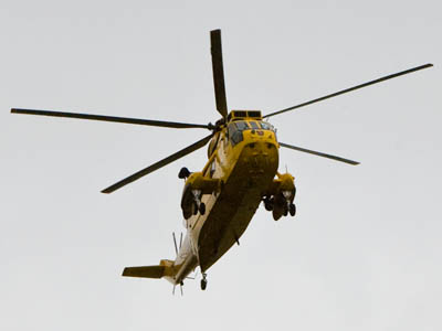 The RAF Valley Sea King was in action rescuing three people yesterday
