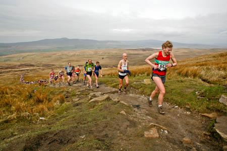 Runners head up Pen-y-ghent in the Three Peaks Race