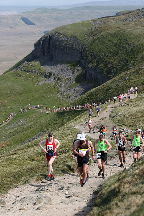 Runners ascend Pen-y-ghent