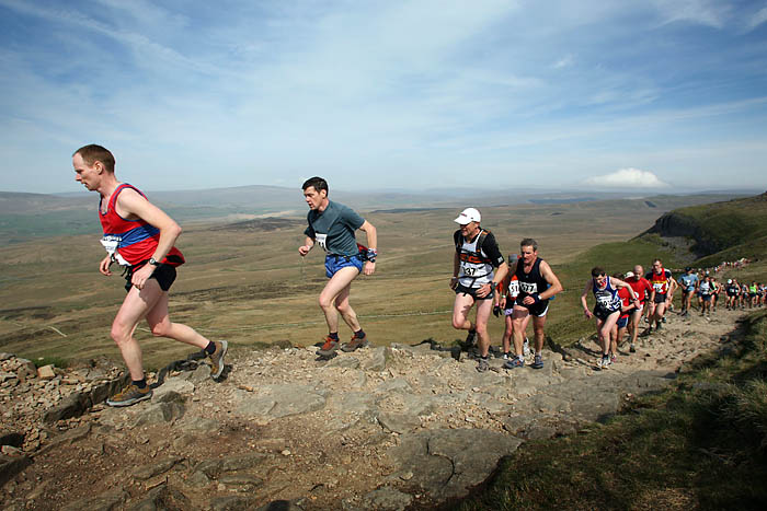 Runners climb towards Pen-y-ghent summit