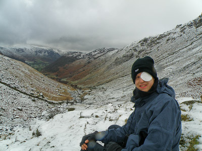 Tom Buckley pauses on his Coast-to-Coast walk in a snowy Lake District