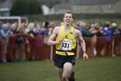 Tom Owens crosses the finish line