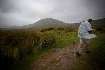 Proof that you don't need to spend £200 on a waterproof: Chris models a giveaway plastic poncho as the heavens open
