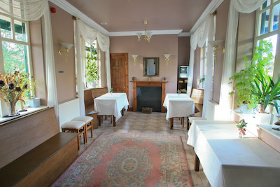 The old waiting room at the station has been transformed into a common room for the bunkhouse