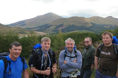 The Whingers pause for a pose, with Ben More in the distance