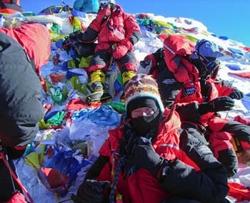 The Caudwell Xtreme Everest team on the summit of the world's highest peak