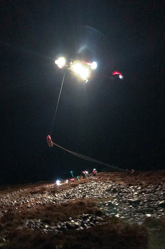 The injured walker is winched into the helicopter. Photo: Aberdyfi SRT