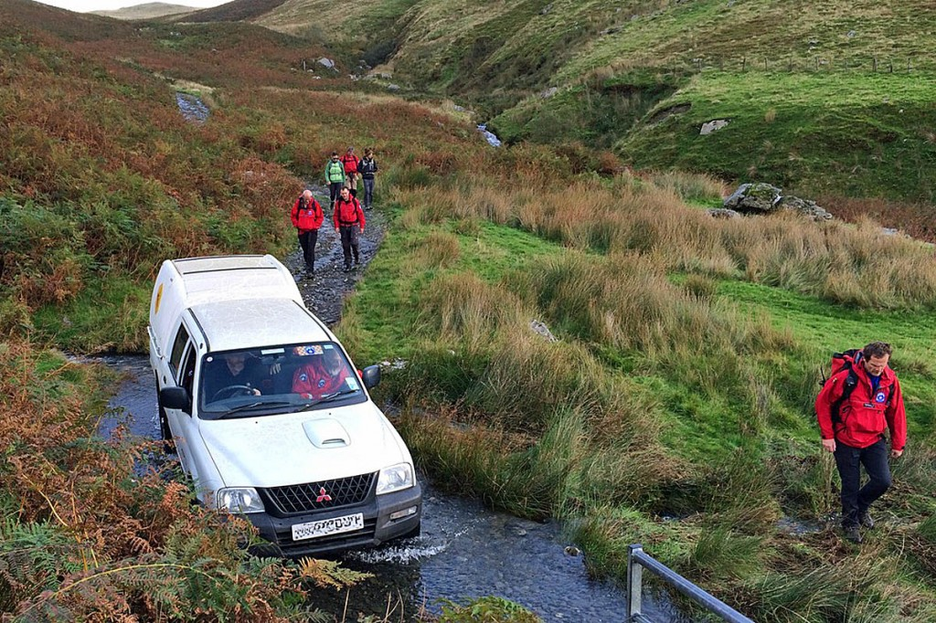 Team members escort the 4x4 vehicle bringing the injured girl from the hill. Photo: Aberdyfi SRT