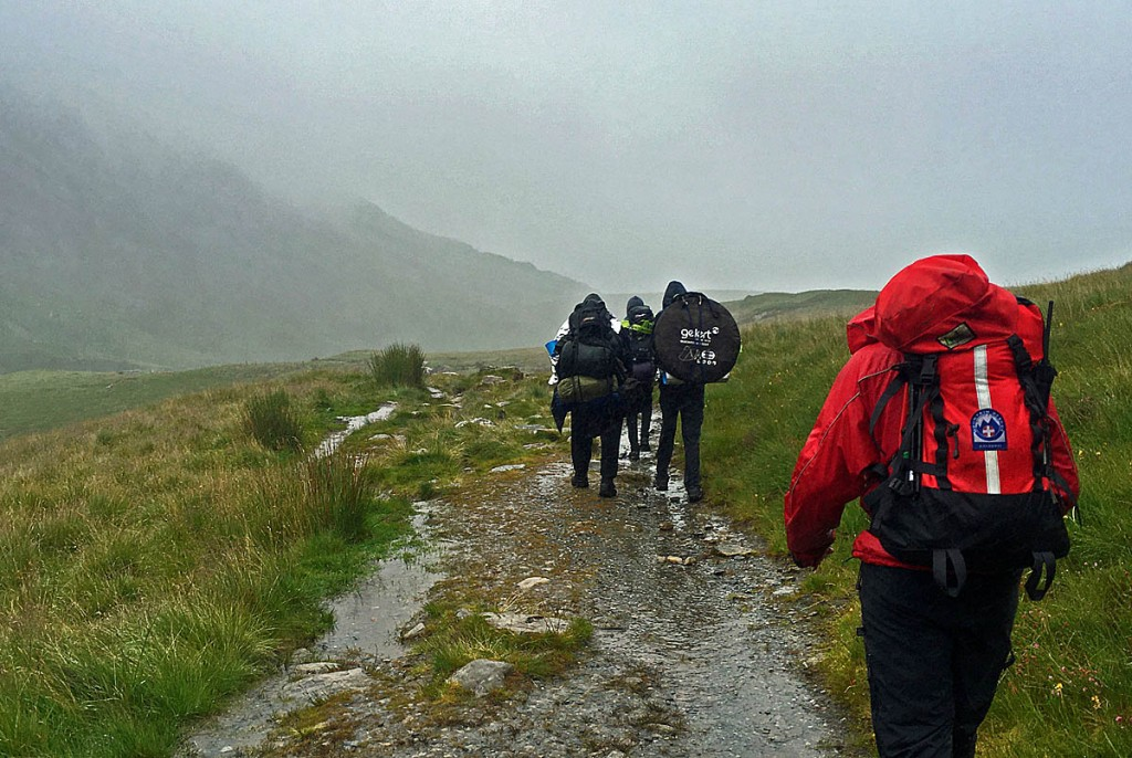 Rescuers accompany the lost walkers to safety. Photo: Aberdyfi SRT