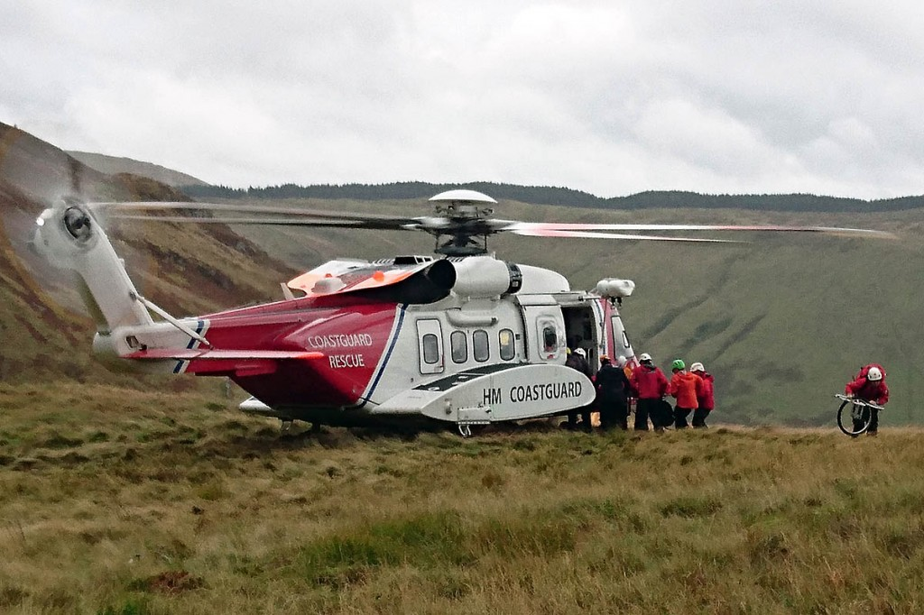 The injured walker is placed in the Coastguard helicopter. Photo: Aberdyfi SRT