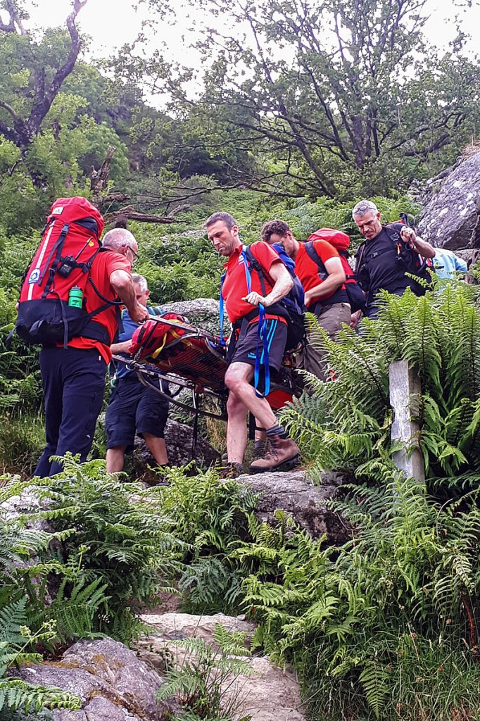 Rescuers stretcher the injured walker down the Minffordd steps. Photo: Aberdyfi SRT