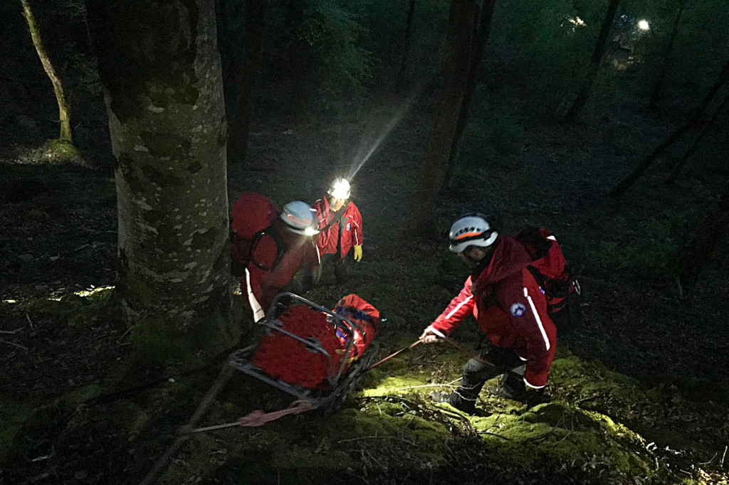 The injured man is lowered down the steep slope. Photo: Aberdyfi SRT