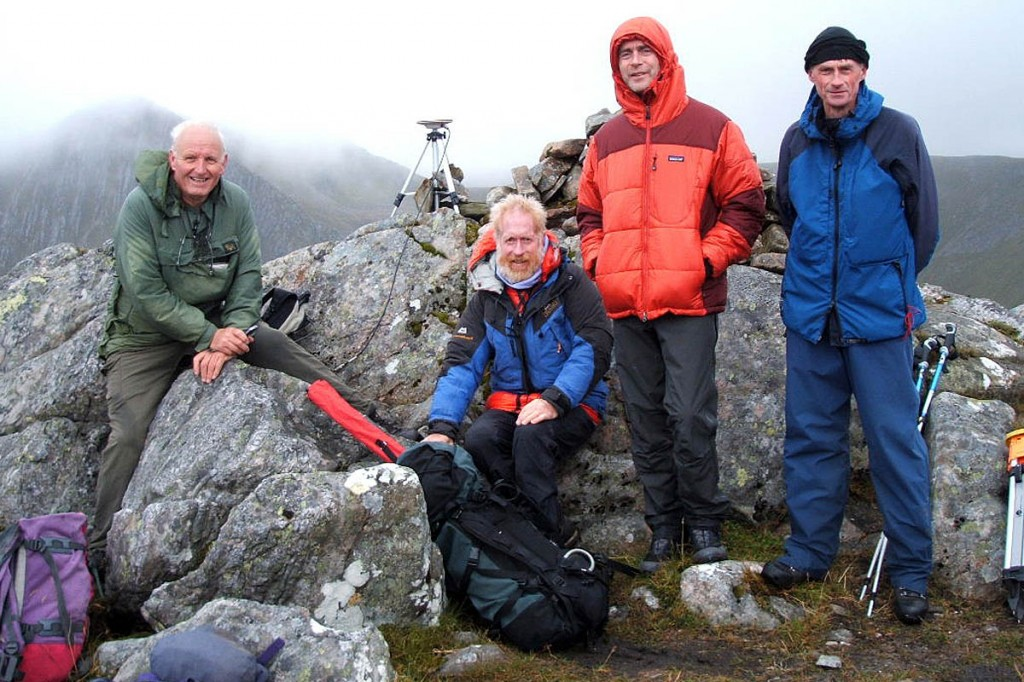 Andy Nisbet, second from left, with Graham Jackson, right, and SMC members on the summit of Sgùrr a' Bhac Chaolais in 2012. Photo: John Barnard