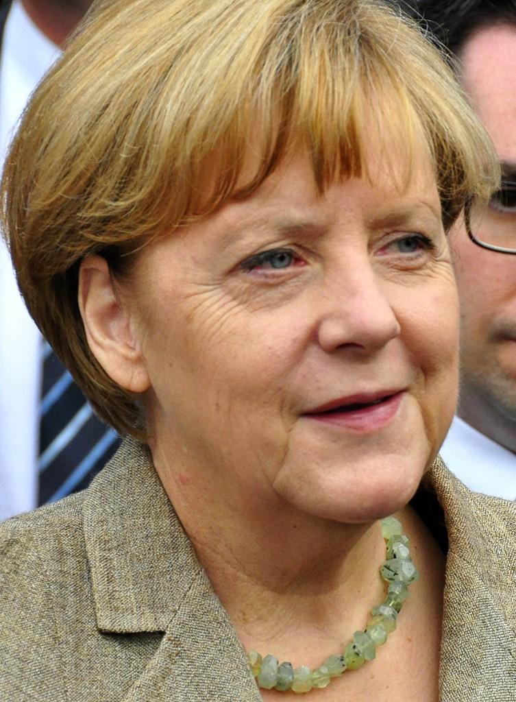 grough — Angela Merkel receives walking guides from Prime ...