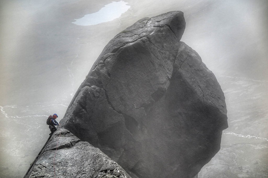 Anna Taylor ascends the final section of Cioch Nose on Skye in rain. Photo: Neil Gresham
