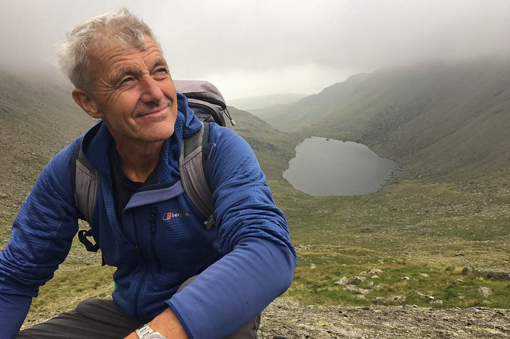 Paul Rose takes a break above Goats Water on his ascent of The Old Man of Coniston. Photo: BBC