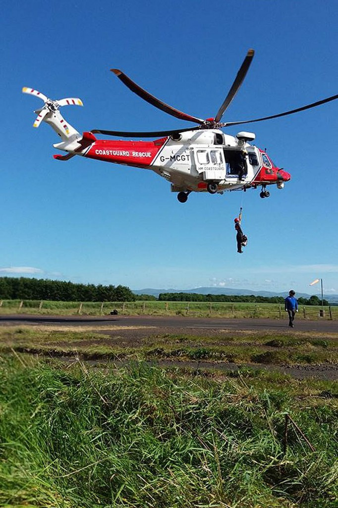 Team members had just finished training with the new Coastguard AgustaWestland helicopter. Photo: BSARU